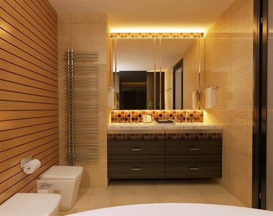 Double vanity tile bathroom with ceiling lights above the mirror.