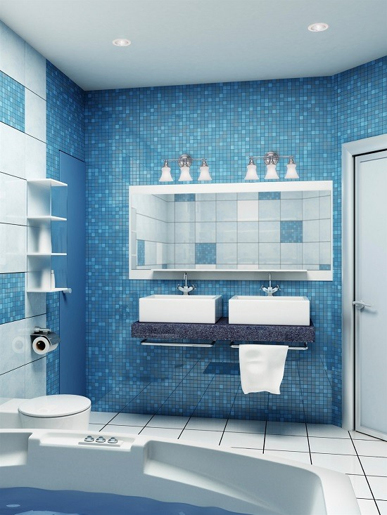 Bright blue bathroom with double sinks and vanity lights over either side of the mirror.